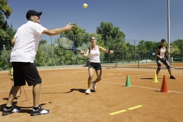 Cardio tennis trainer with clients